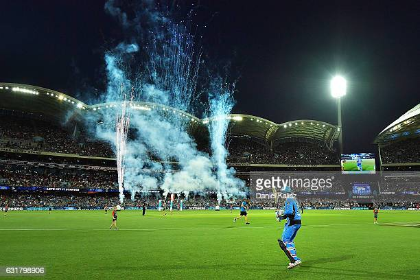Ben Dunk of the Adelaide Strikerss runs out to bat during the Big Bash League match between the Adelaide Strikers and the Melbourne Renegades at...