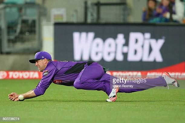 Ben Dunk of the Hurricanes dives for a catch during the Big Bash League match between Hobart Hurricanes and Brisbane Heat at Blundstone Arena on...
