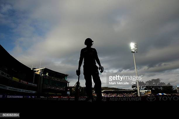 Ben Dunk of the Hurricanes prepares to walk onto the field during the Big Bash League match between the Hobart Hurricanes and the Sydney Thunder at...