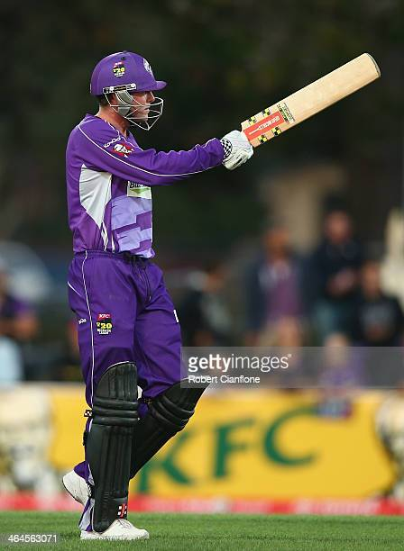 Ben Dunk of the Hurricanes raises his bat after scoring his half century during the Big Bash League match between the Hobart Hurricanes and Brisbane...