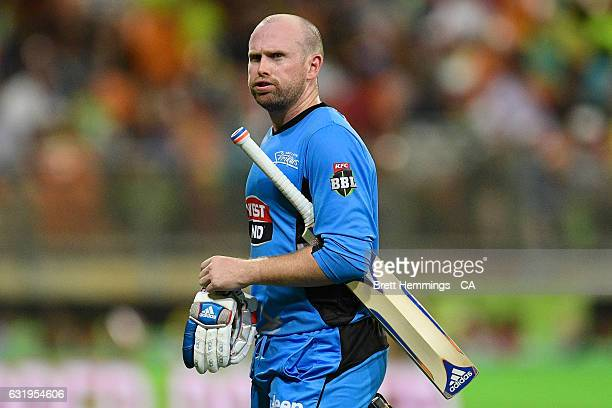 Ben Dunk of the Strikers walks from the field after being dismissed by Shane Watson of the Thunder during the Big Bash League match between the...