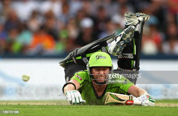 Ben Dunk of the Thunder dives to make his ground during the T20 Big Bash League match between the Sydney Thunder and the Perth Scorchers at ANZ...