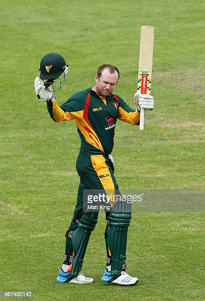 Ben Dunk of the Tigers celebrates and acknowledges the crowd after scoring 150 during the Matador BBQs One Day Cup match between Queensland and...