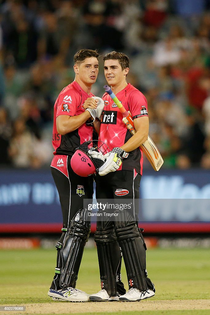 Ben Dwarshuis and Sean Abbott of the Sydney Sixers celebrate the win at the end of the Big Bash League match between the Melbourne Stars and the Sydney Sixers at Melbourne Cricket Ground on January 21, 2017 in Melbourne, Australia.