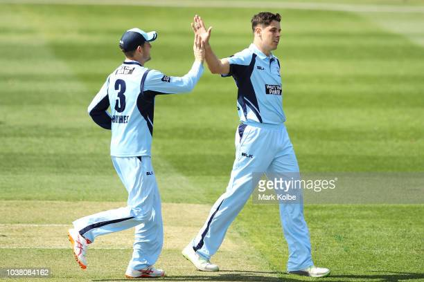 Jackson Coleman of Victoria celebrates with his team mates after taking the wicket of Steve O'Keefe of the NSW Blues during the JLT One Day Cup match...