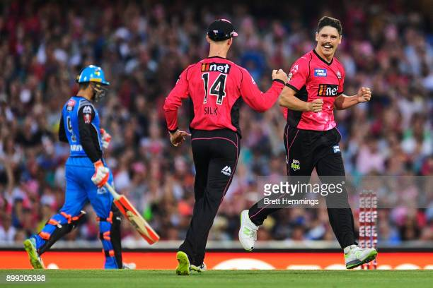 Ben Dwarshuis of the Sixers celebrates with team mates after taking the wicket of Colin Ingram of the Strikers during the Big Bash League match...