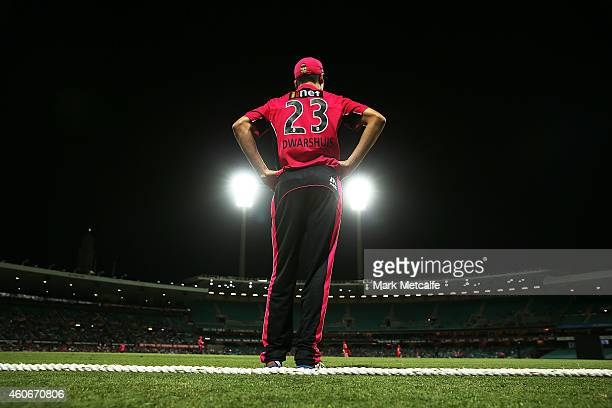 Ben Dwarshuis of the Sixers fields on the boundary rope during the Big Bash League match between the Sydney Sixers and Melbourne Renegades at Sydney...