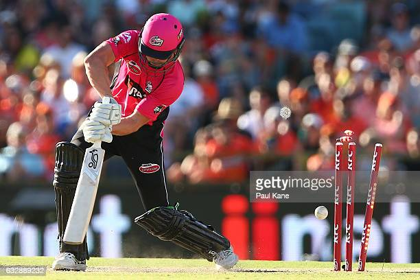 Ben Dwarshuis of the Sixers is bowled by Tim Bresnan of the Scorchers during the Big Bash League match between the Perth Scorchers and the Sydney...