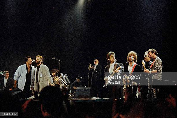 Ben E King Ringo Starr Ray Cooper George Harrison Jeff Lynne Elton John and Eric Clapton perform on stage at Wembley Arena for The Princes Trust on...