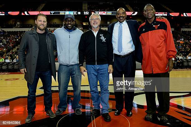Ben Eager Desmond Clark Ron Kittle Mickey Johnson and Bob Love of the posed for a photo center court during the game between the Windy City Bulls and...