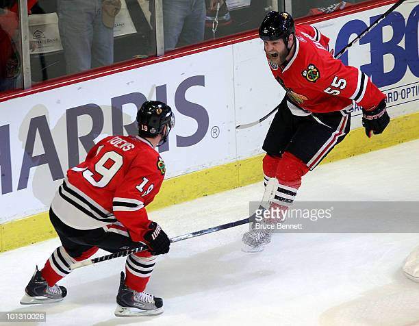 Ben Eager of the Chicago Blackhawks celebrates with Jonathan Toews after scoring a goal against the Philadelphia Flyers in the second period of Game...