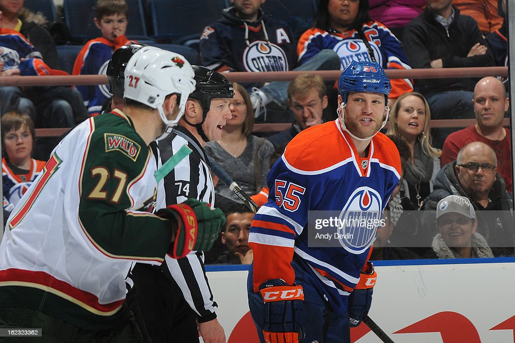 Ben Eager #55 of the Edmonton Oilers exchanges words with Mike Rupp #27 of the Minnesota Wild on February 21, 2013 at Rexall Place in Edmonton, Alberta, Canada.
