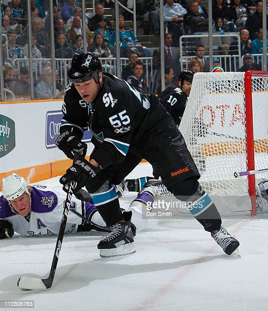 Ben Eager of the San Jose Sharks skates the puck to safety against the Los Angeles Kings in Game One of the Western Conference Quarterfinals during...