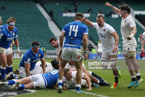 Ben Earl and Tom Curry celebrate as Jack Willis of England goes over to score their side's fifth try during the Guinness Six Nations match between...