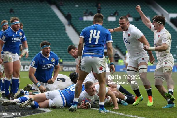 Ben Earl and Tom Curry of England celebrate as Jack Willis of England goes over to score their side's fifth try during the Guinness Six Nations match...
