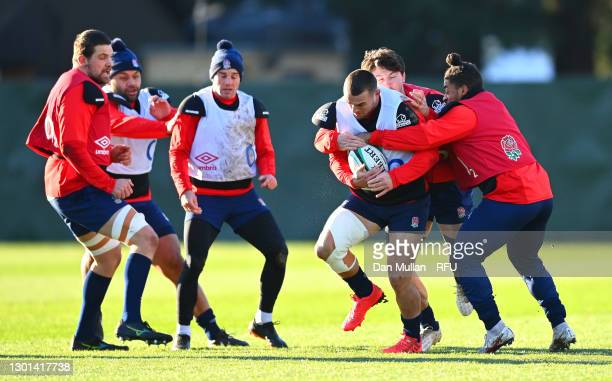 Ben Earl of England is tackled by Tom Curry and Paolo Odogwu of England during the England Training Session ahead of the Guinness Six Nations match...
