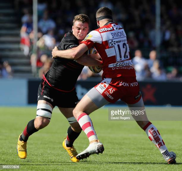 Ben Earl of Saracens is tackled by Andy Symons during the Aviva Premiership match between Saracens and Gloucester Rugby at Allianz Park on May 5 2018...