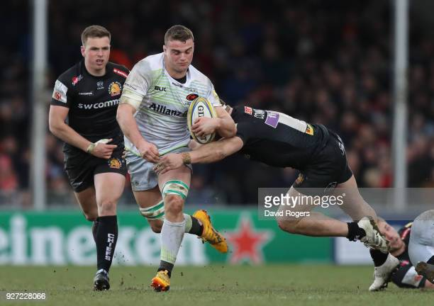 Ben Earl of Saracens is tackled during the Aviva Premiership match between Exeter Chiefs and Saracens at Sandy Park on March 4 2018 in Exeter England