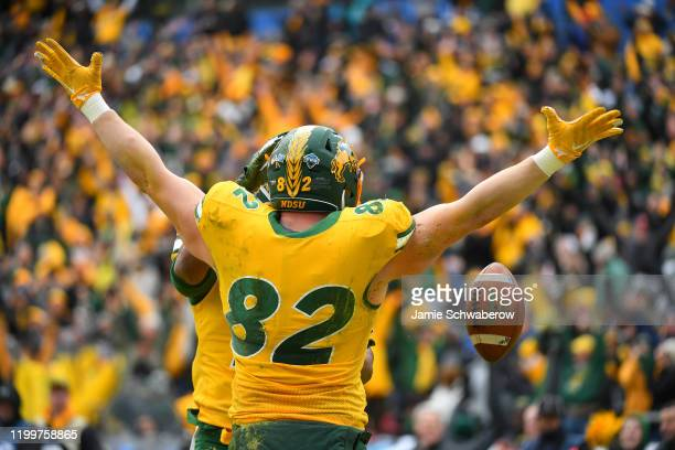 Ben Ellefson of the North Dakota State Bison celebrates a play against the James Madison Dukes during the Division I FCS Football Championship held...