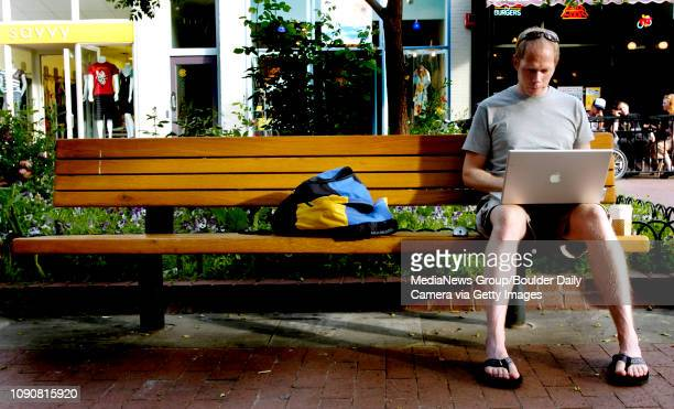 Ben Ellingson sits on the Pearl Street Mall checking his email in Boulder Colorado June 05 2007 Ellingson works from home and likes to come to the...