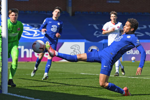 Ben Elliott of Chelsea lunges for the ball during the Chelsea U18 v AFC Fylde U18 FA Youth Cup at Kingsmeadow on April 2, 2021 in Kingston upon...