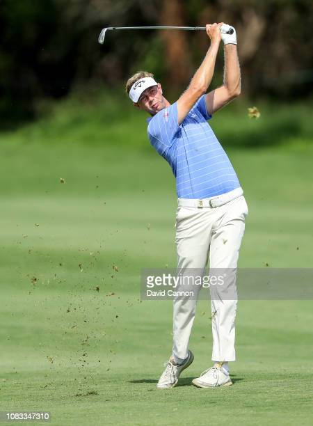 Ben Evans of England plays his second shot on the par 4 17th hole during the final round of the Alfred Dunhill Championships at Leopard Creek Country...