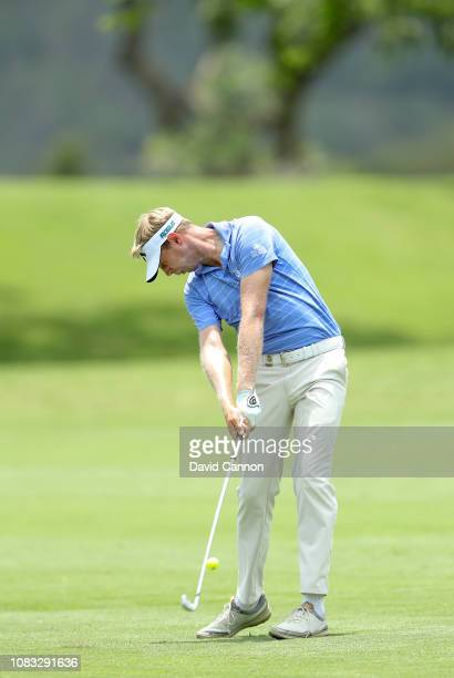 Ben Evans of England plays his second shot on the par 5 second hole during the final round of the Alfred Dunhill Championships at Leopard Creek...