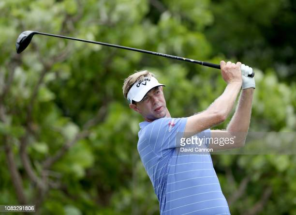 Ben Evans of England plays his tee shot on the par 5 second hole during the final round of the Alfred Dunhill Championships at Leopard Creek Country...
