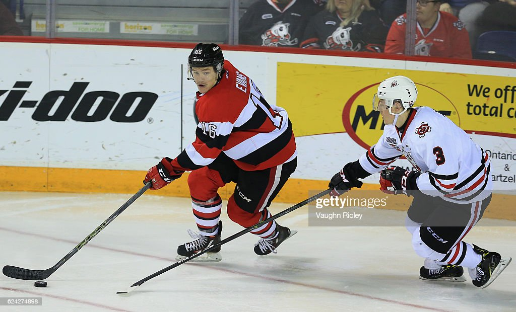 Ben Evans #16 of the Ottawa 67's and Ben Jones #3 of the Niagara IceDogs battle for the puck during the third period of an OHL game at the Meridian Centre on November 18, 2016 in St Catharines, Canada.