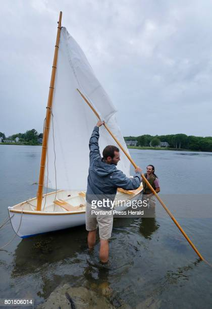 Ben Fearn of Aiea Hawaii left and Jarrett Adorno of Bronx NY students from the Landing School launch a 13foot Catspaw dinghy in Kennebunkport The...