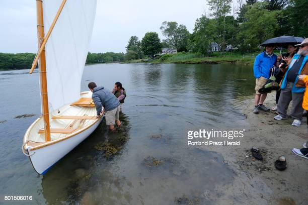 Ben Fearn of Aiea Hawaii left and Jarrett Adorno of Bronx NY students from the Landing School launch a 13foot Catspaw dinghy in Kennebunkport