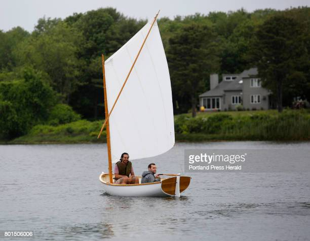 Ben Fearn of Aiea Hawaii right and Jarrett Adorno of Bronx NY students from the Landing School launch a 13foot Catspaw dinghy in Kennebunkport The...
