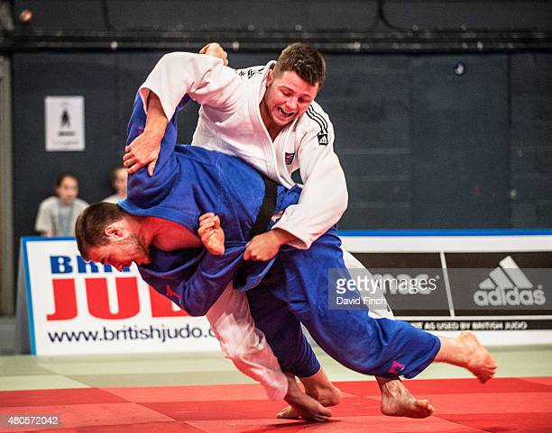 Ben Fletcher of Great Britain counters Mateja Glusac of Serbia by a wazari eventually winning the match by an ippon as he progressed to the u100kg...
