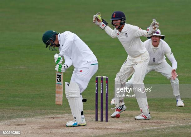 Ben Foakes and Keaton Jennings of England Lions appeal successfully for the wicket of South Africa A's Duanne Olivier during day 4 of the match...