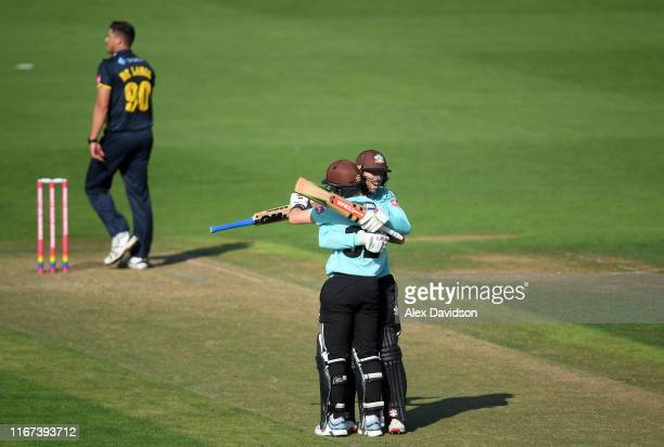 Ben Foakes and Ollie Pope of Surrey celebrate victory during the Vitality Blast match between Glamorgan and Surrey at Sophia Gardens on August 11...