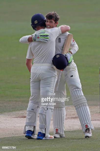 Ben Foakes of England Lions celebrates with teammate Jack Leach after reaching a century during day 2 of the match between England Lions and South...