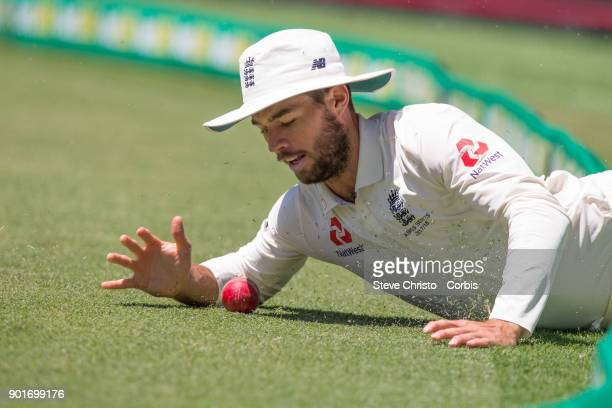 Ben Foakes of England slides into the boundry while trying to stop a 4 during day three of the Fifth Test match in the 2017/18 Ashes Series between...