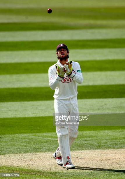 Ben Foakes of Surrey catches a ball during day two of the Specsavers County Championship Division One match between Surrey and Lancashire at The Kia...
