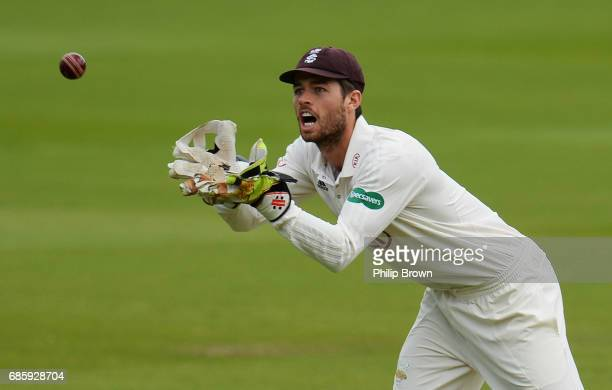 Ben Foakes of Surrey catches the ball during day two of the Specsavers County Championship Division One cricket match between Middlesex and Surrey at...