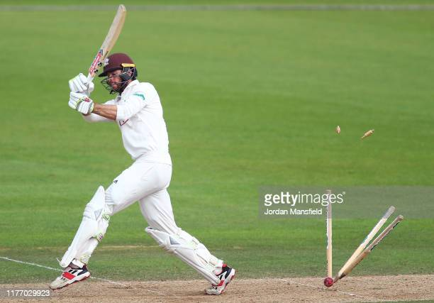 Ben Foakes of Surrey is bowled out by Jack Blatherwick of Nottinghamshire during Day Three of the Specsavers County Championship Divsion One match...