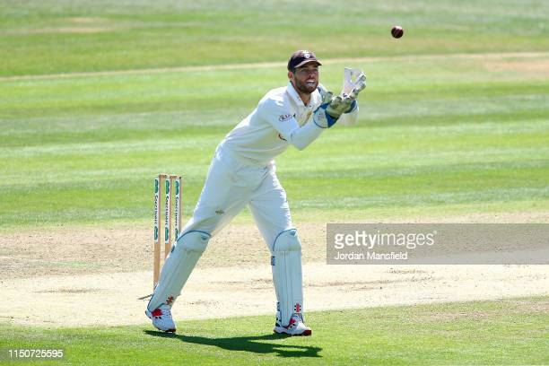 Ben Foakes of Surrey makes a catch during day two of the Specsavers County Championship Division One match between Kent and Surrey on May 21, 2019 in...