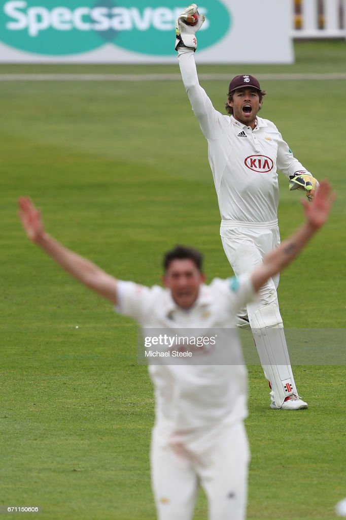Ben Foakes the wicketkeeper of Surrey appeals unsuccessfully with Mark Footit during day one of the Specsavers County Championship Division One match between Warwickshire and Surrey at Edgbaston on April 21, 2017 in Birmingham, England.