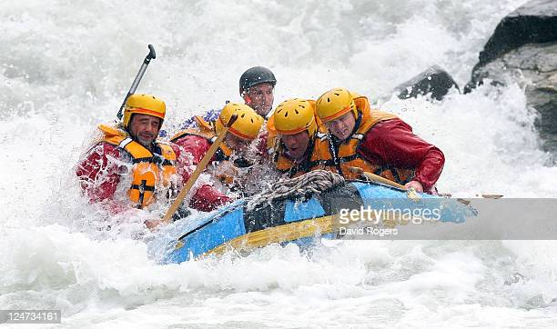 Ben Foden Nick Easter Simon Shaw and Chris Ashton of England shoot the rapids during a white water raft run during an England IRB Rugby World Cup...