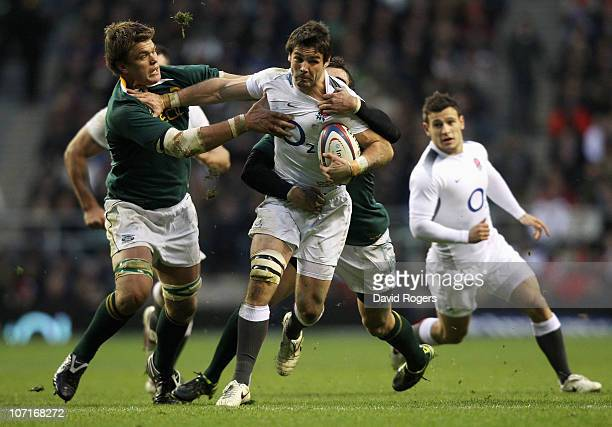 Ben Foden of England is tackled by Juan Smith of South Africa during the Investec Challenge match between England and South Africa at Twickenham...