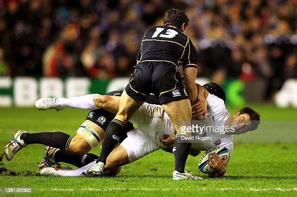 Ben Foden of England is tackled by Nick De Luca and Alasdair Strokosch of Scotland during the RBS Six Nations match between Scotland and England at...