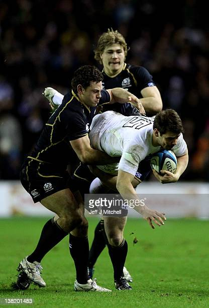 Ben Foden of England is tackled by Nick De Luca of Scotland during the RBS Six Nations match between Scotland and England at Murrayfield Stadium on...