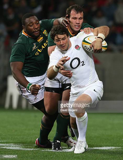 Ben Foden of England moves away from Bismarck du Plessis and Tendai Mtawarira during the third test match between the South Africa Springboks and...