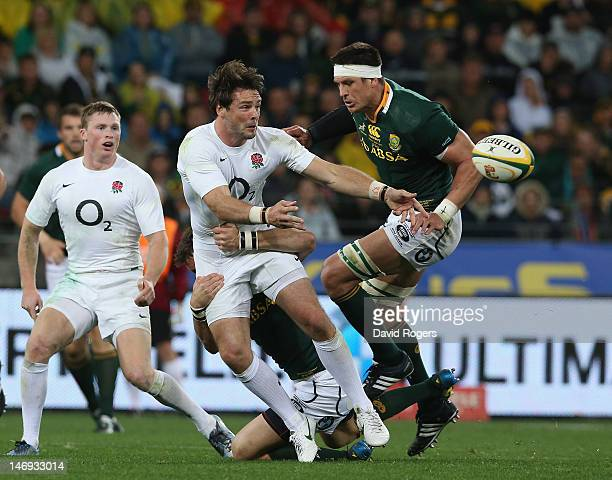 Ben Foden of England off loads the ball during the third test match between the South Africa Springboks and England at the Nelson Mandela Bay Stadium...