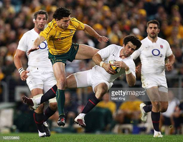Ben Foden of England takes a high ball in front of Adam Ashley-Cooper of the Wallabies during the Cook Cup Test Match between the Australian...