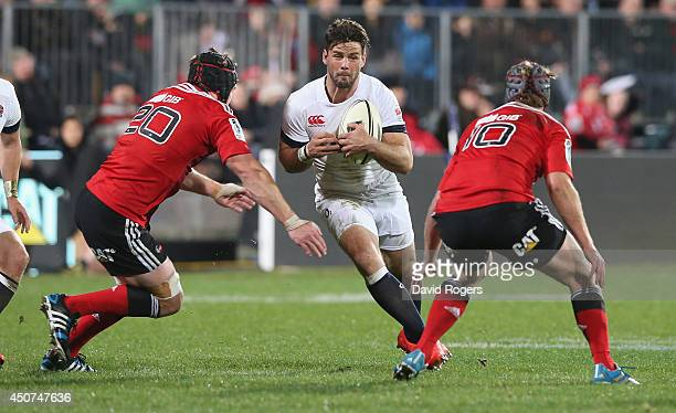 Ben Foden of England takes on Matt Todd and Tyler Bleyendaal during the match between the Crusaders and England at the AMI Stadium on June 17 2014 in...